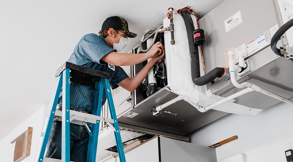 furnace repair in hermiston oregon techician repairs HVAC furnace